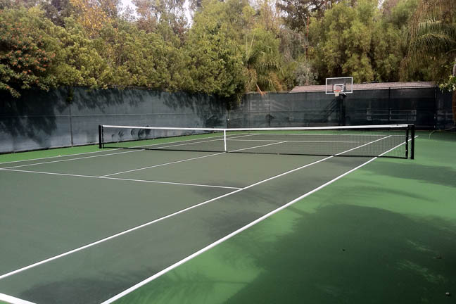 This is a great example of how the simple addition of a basketball hoop to your tennis court provides even more hours of family fun from your court.